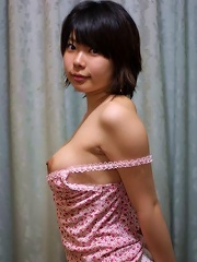 Horny and busty Asian chick poses topless and naked for the camera